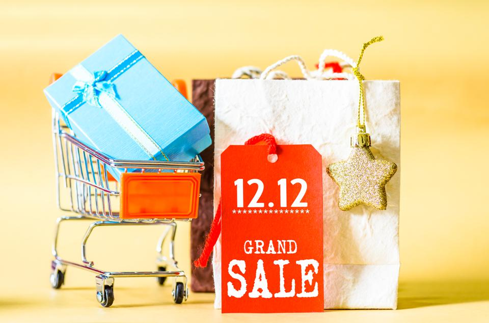 Mini shopping cart and gift box with label tags for 12.12 online shopping sale concept.