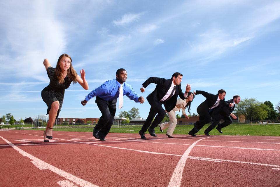 Business people racing on track