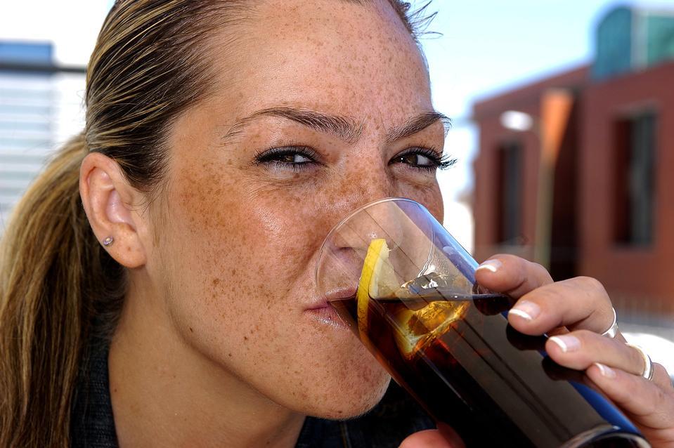 A girl drinking a coke.