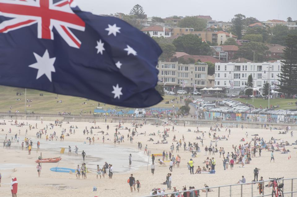 Australian flag and bathers on bondi beach sydney