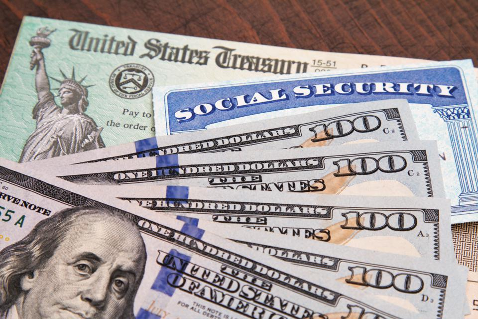 Money: closeup of USA currency with government treasury check and social security card