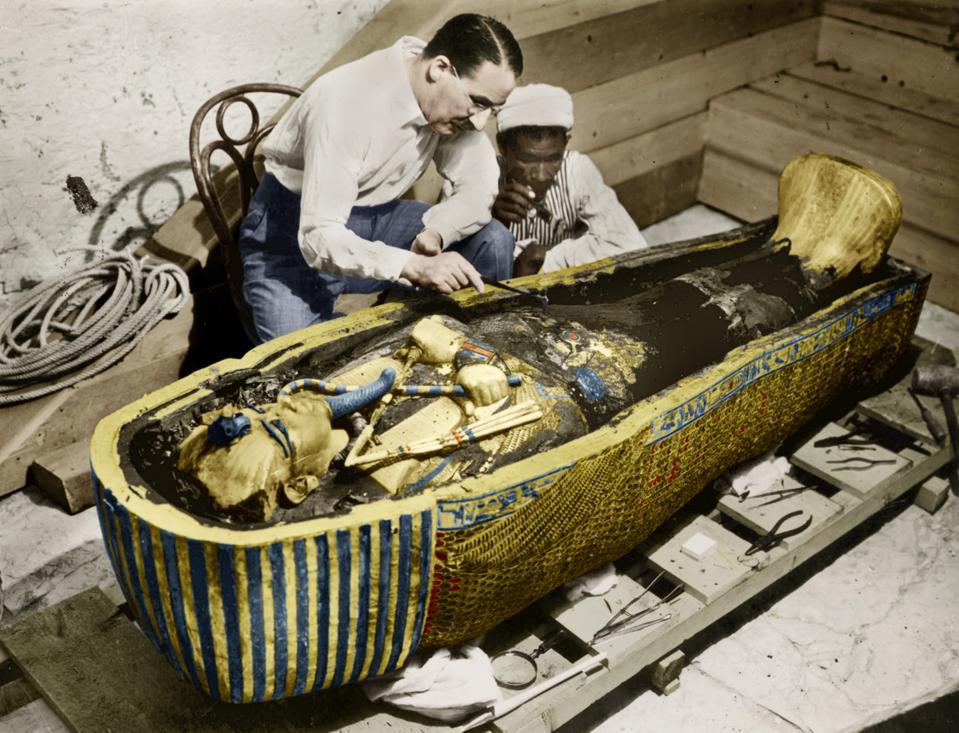Howard Carter (1873-1939) english egyptologist near golden sarcophagus of Tutankhamon (mummy) in Egypt in 1922 (photo Harry Burton) colorized document