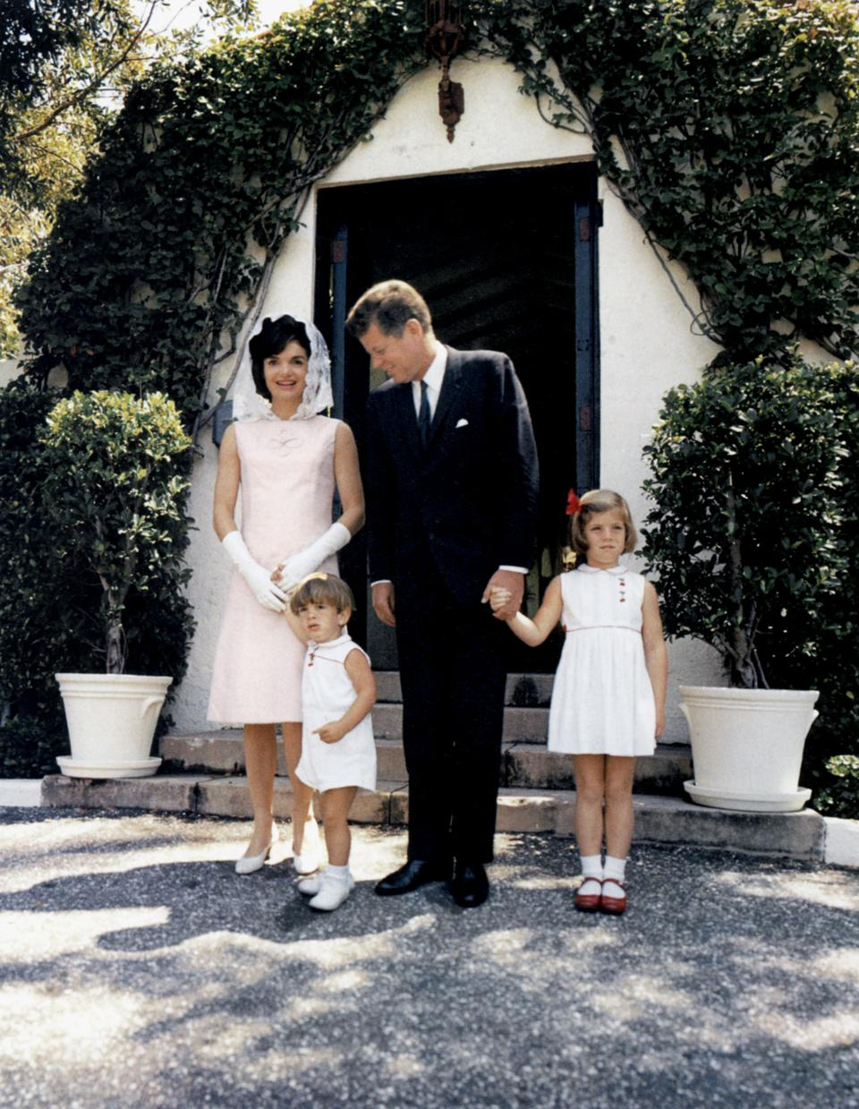 President John Kennedy and his wife Jackie and their children John Jr and Caroline at Palm Beach, Florida april 14, 1963 (Jackie wearing a mauve linen dress by Oleg Cassini created in 1963)