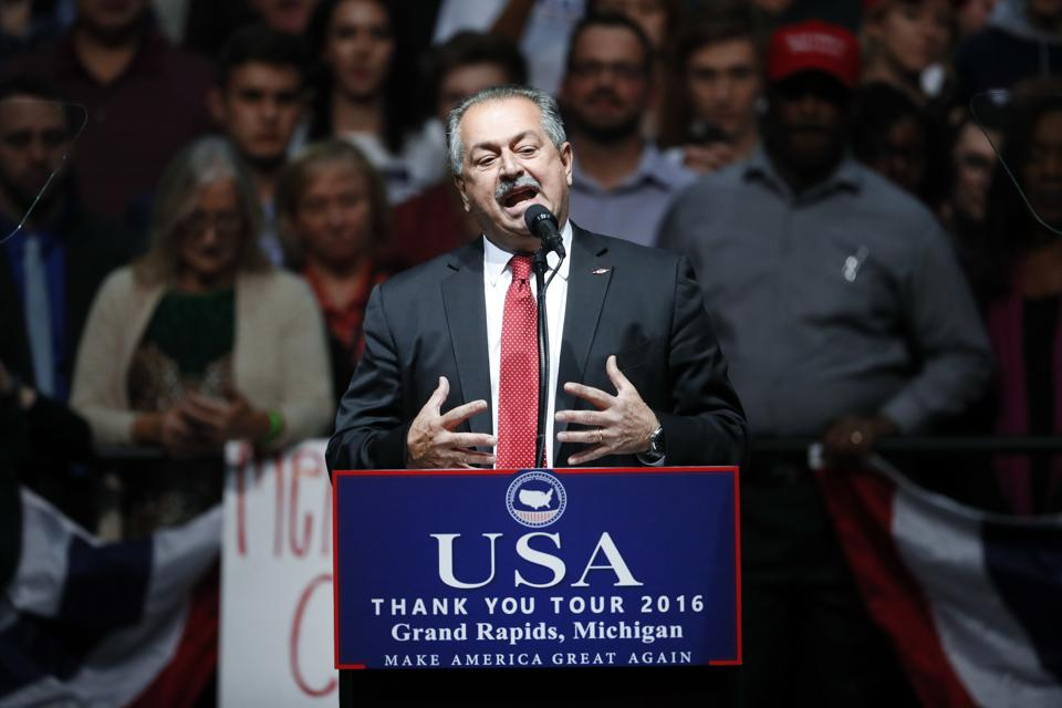 Andrew Liveris, Chairman and Chief Executive Officer, Dow Chemical Company, speaks at a rally for President-elect Donald Trump in Grand Rapids, Mich., Friday, Dec. 9, 2016. (AP Photo/Paul Sancya)