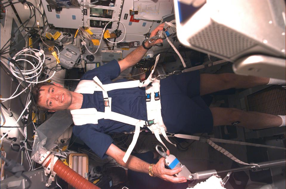 Astronaut Jeffrey S. Ashby runs on a treadmill as part of a test with the Treadmill Vibration Isolation System