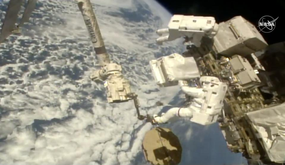 Astronauts Luca Parmitano (lower right) and Andrew Morgan on a spacewalk.