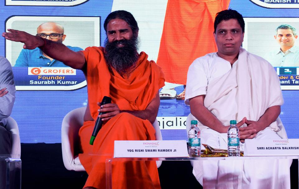 ndian yoga guru Baba Ramdev (L) and Patanjali Ayurveda Managing Director Acharya Balkrishna.