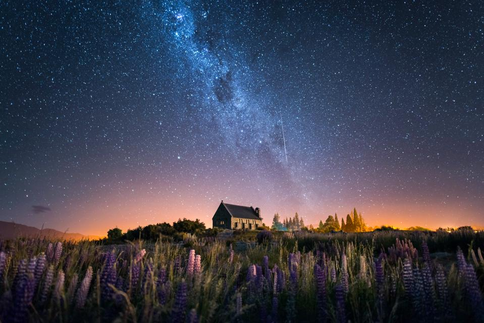 The Church of the Good Shepherd and the Milky Way with lupine in bloom, Lake Tekapo, New Zealand