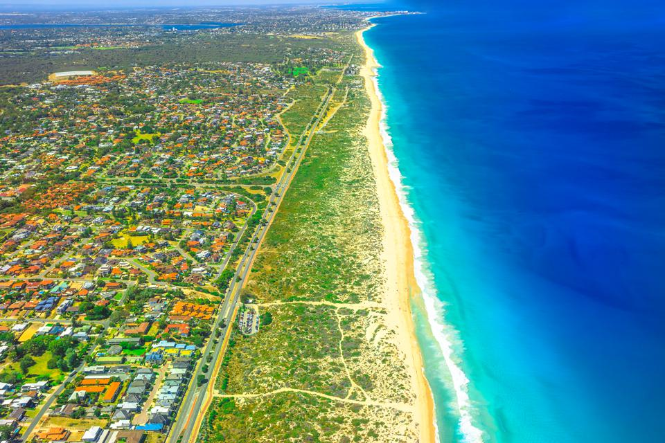 Aerial view of the stunning blue waters of Scarborough Beach