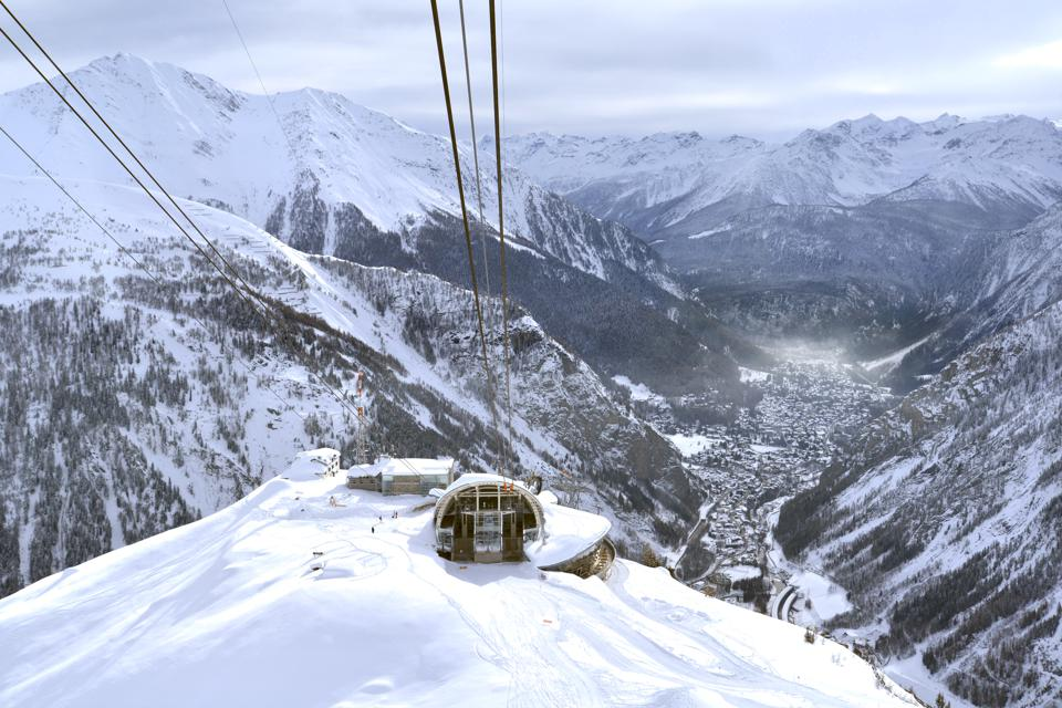 Pavillon du Mont-Fréty, panorama from Mont Blanc massif, Italy.  Courmayeur, Valle d'Aosta, Italy - January 14, 2018: High angle view of the Pavillon du Mont-Fréty cable car station of the new revolving cable car called Skyway (The eighth wonder of the world). In the background Courmayeur, La Palud, Entreves, and snowy mountains, January 14, 2018 in Courmayeur, Valle d'Aosta, Italy.