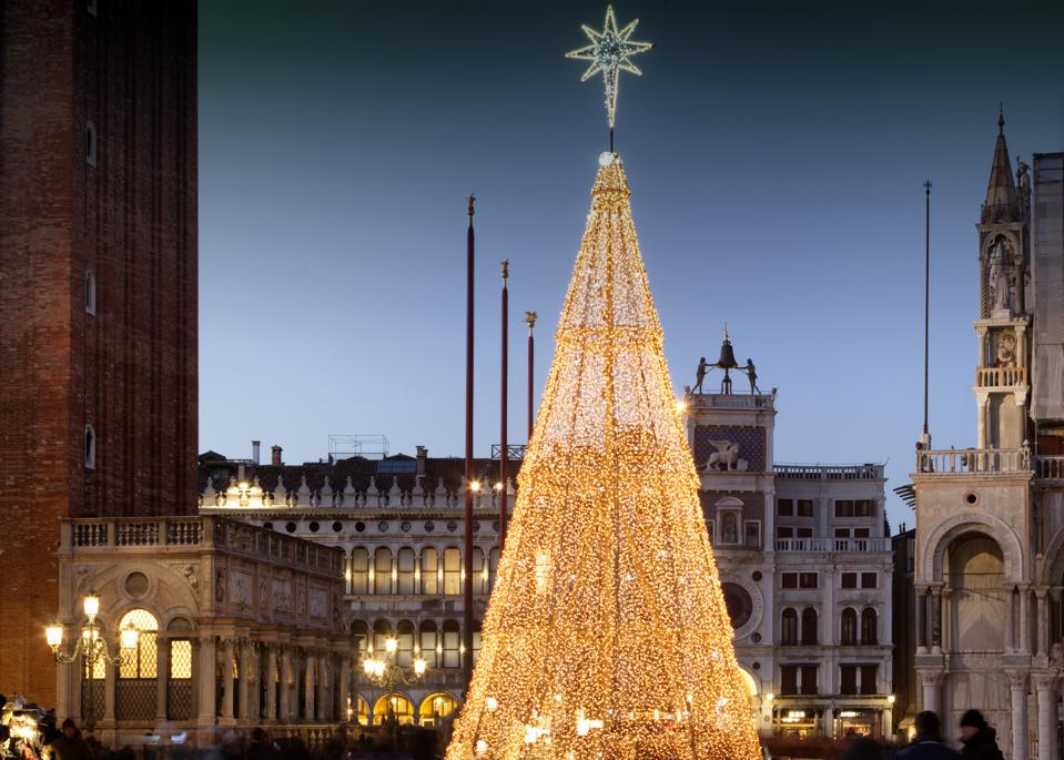 Chistmas tree Venice, Italy - December 17, 2017: the luminous installation at Mark's square, for the Holy Day on the monument's background