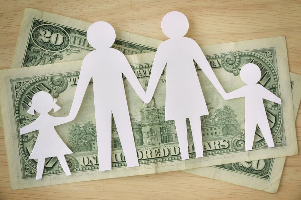 Paper family cut-out on dollars banknotes - Family budget concept