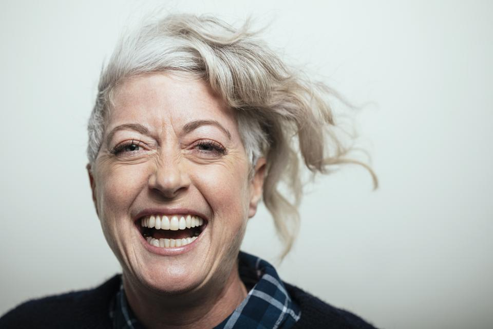 Portrait confident, enthusiastic cool mature woman laughing