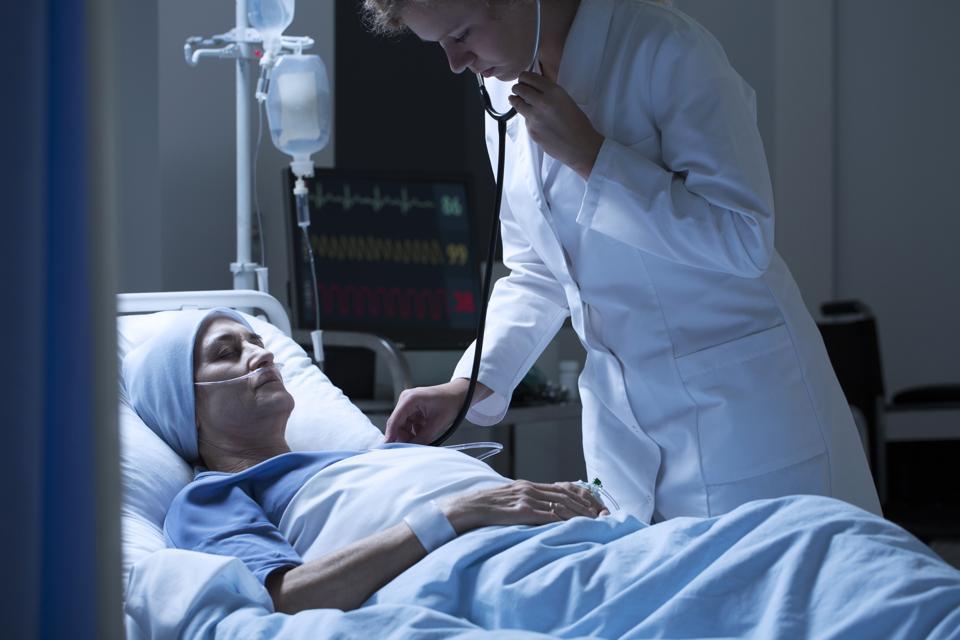 Doctor examining sick woman