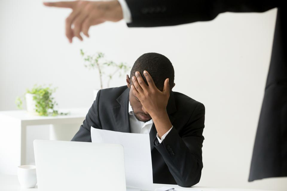 Frustrated hopeless african-american office worker getting fired from job concept