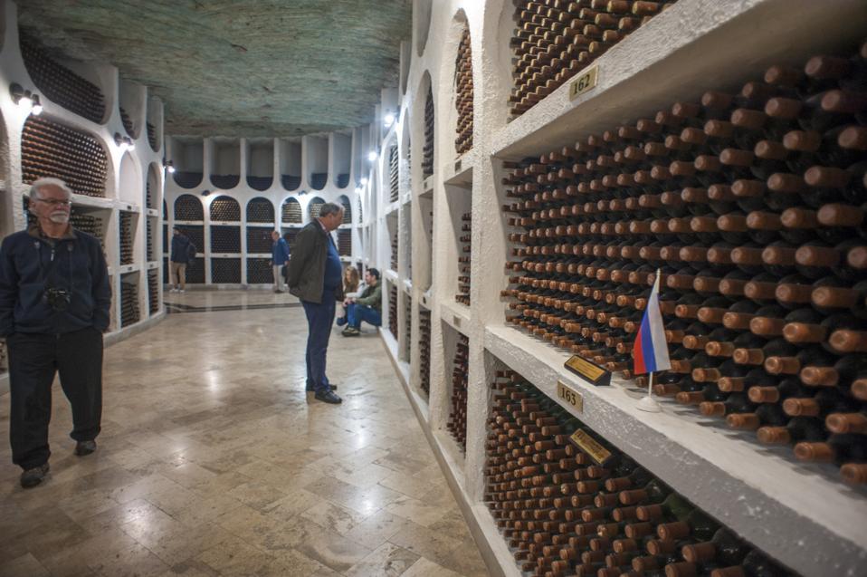 Tourists admiring the wine cellars of Cricova Winery,...