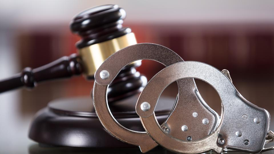Close-up Of Handcuffs And Gavel