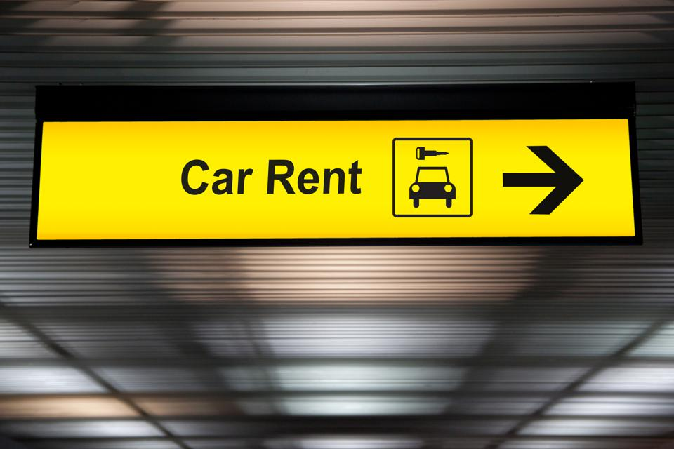sign with arrow point to rent a car service at the airport for passenger who want to hide a car for travel around city. freedom transportation for convenient travel