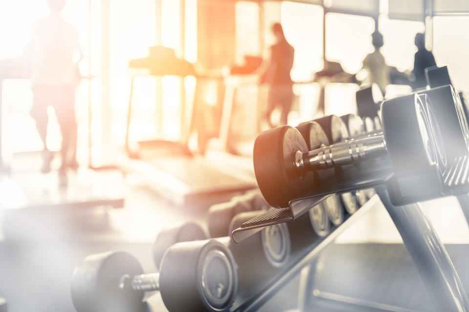 Rows of dumbbells in the gym with hign contrast and monochrome color tone