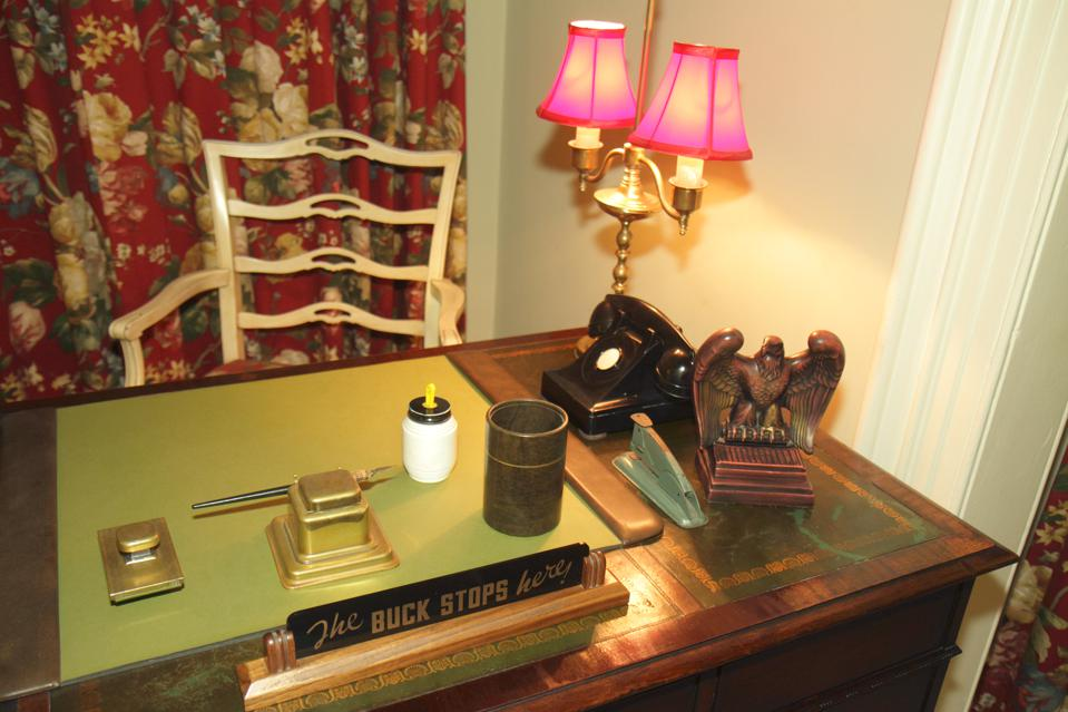 The buck stops here sign on a desk inside The Little White House.