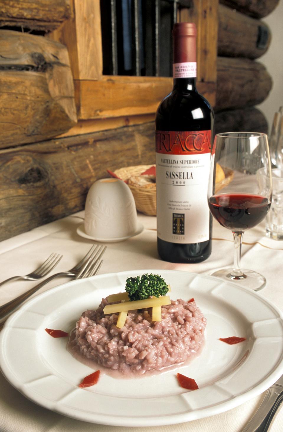 Rice with Sassella vine and Bitto cheese. Rini farm holidays. Bormio. Lombardy. Italy