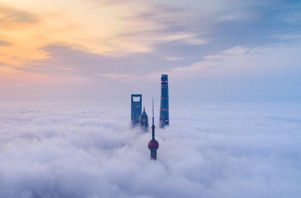 skyscrapers above advection fog in Lujiazui, Shanghai