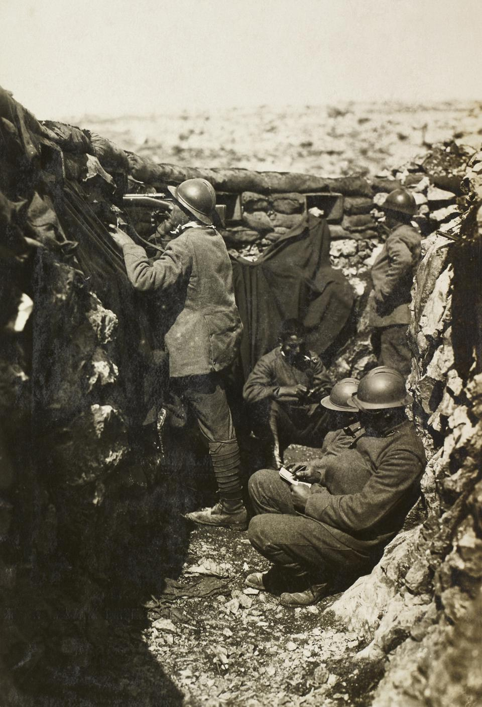 Soldiers in trenches in front of Mount Ermada