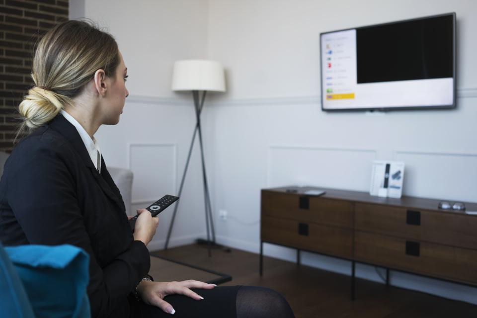Businesswoman using smart tv