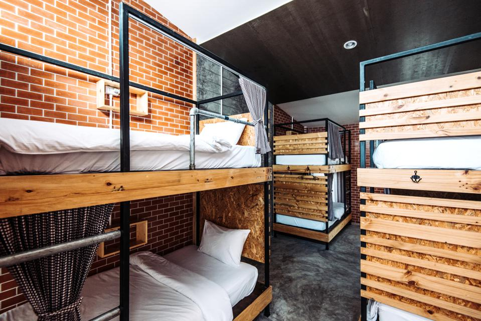 Dormitory room with bunk beds in the modern hostel