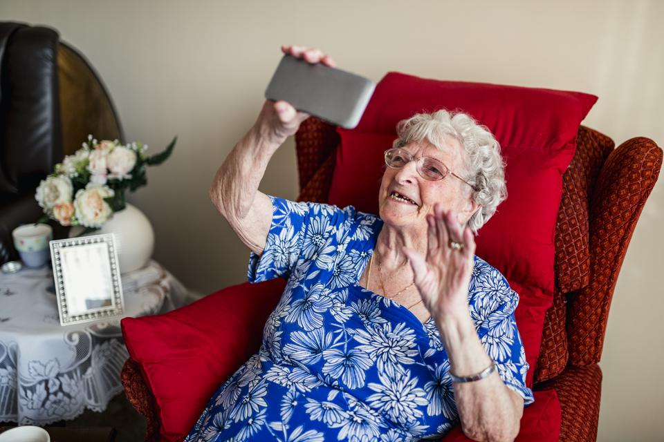 Elderly Woman Using A Mobile Telephone