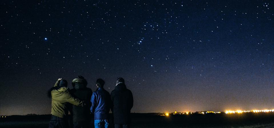 Rear View Of People Against Star Field At Night