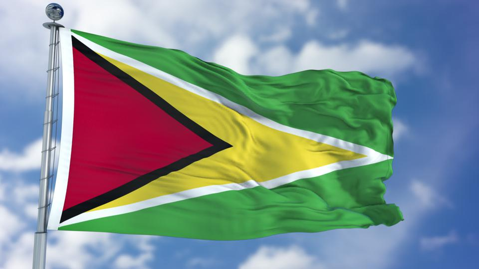 Guyana Flag in a Blue Sky