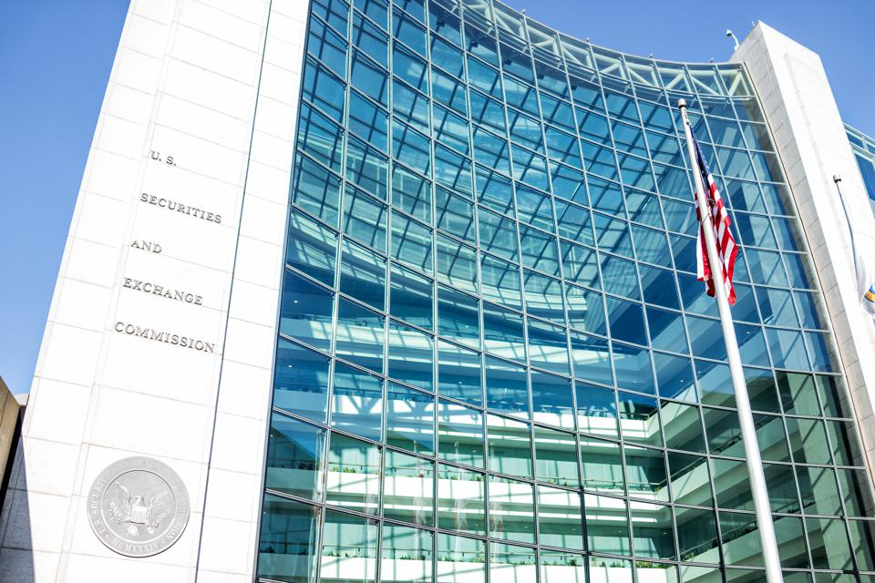 US United States Securities and Exchange Commission SEC entrance architecture modern building sign, logo, american flag, looking up sky, glass windows reflection
