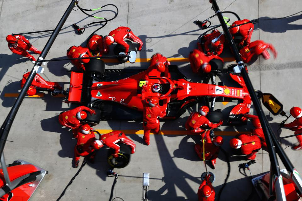 Staff swarm around F1's cars at every race (Mark Thompson/Getty Images)