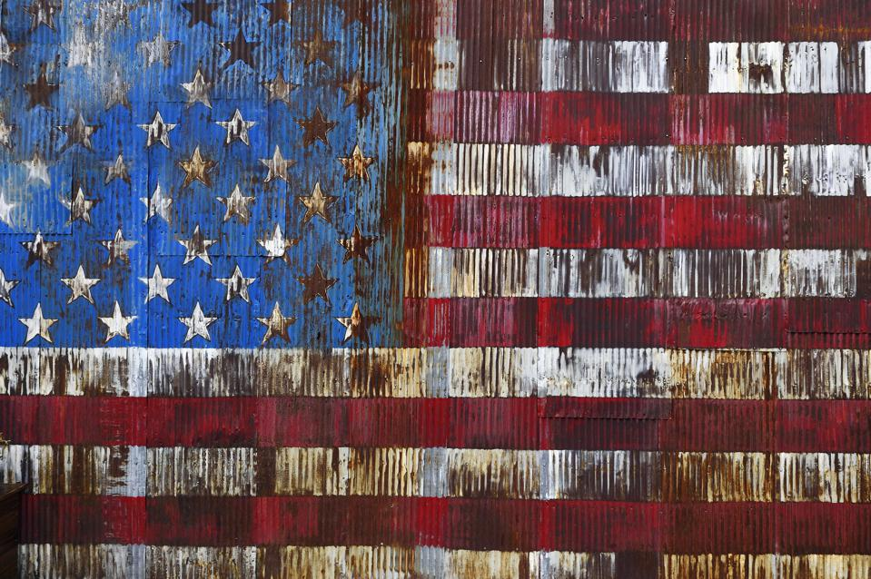 Decaying American Flag painted on a rusty door