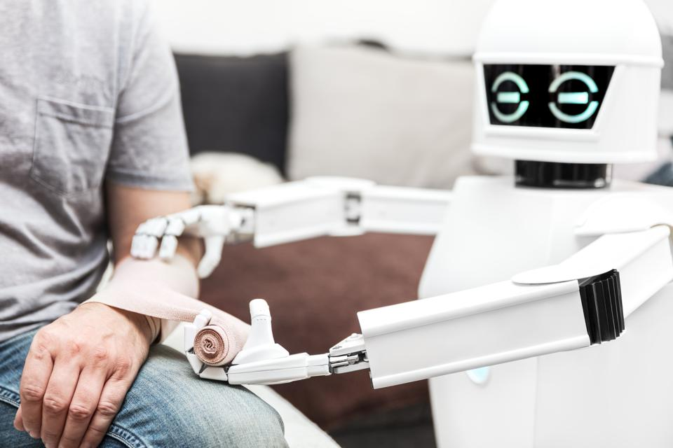 assistance medicine service robot is putting a bandage on a arm of an male patient, at home in the bedroom
