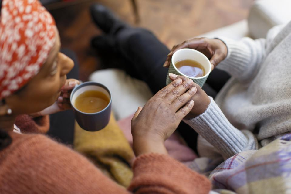 Women friends talking, drinking tea