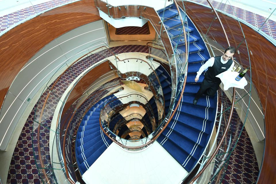 The centrally located circular staircase, here pictured on the Seabourn Encore