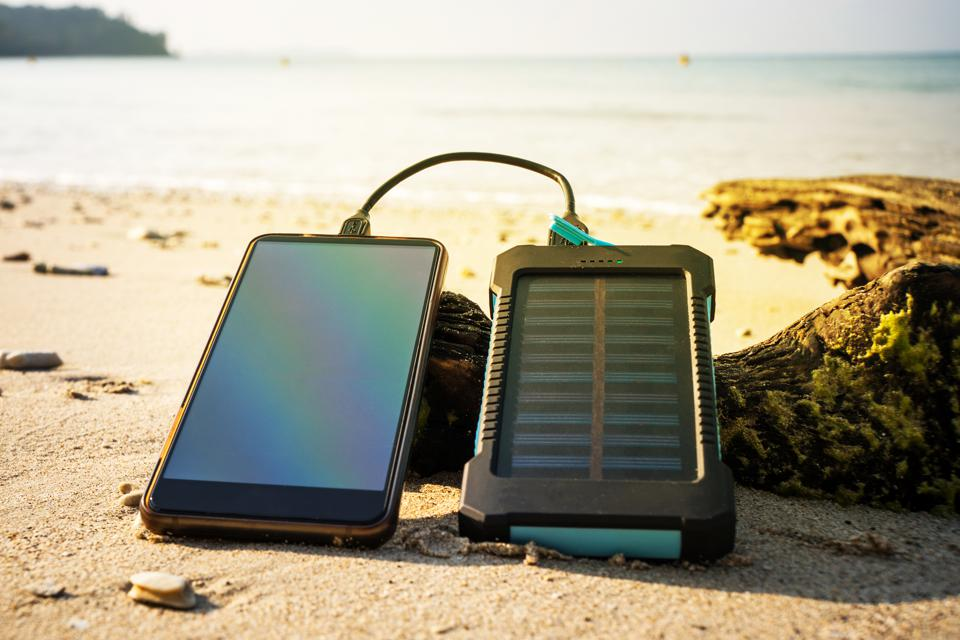 Battery solar energy device on a background