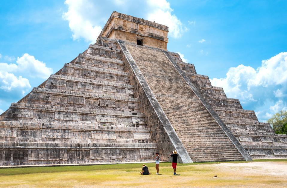 Chichen Itza. Mexico. Archaeological Site. Tousists Under the Imposing Castle (el Castillio)