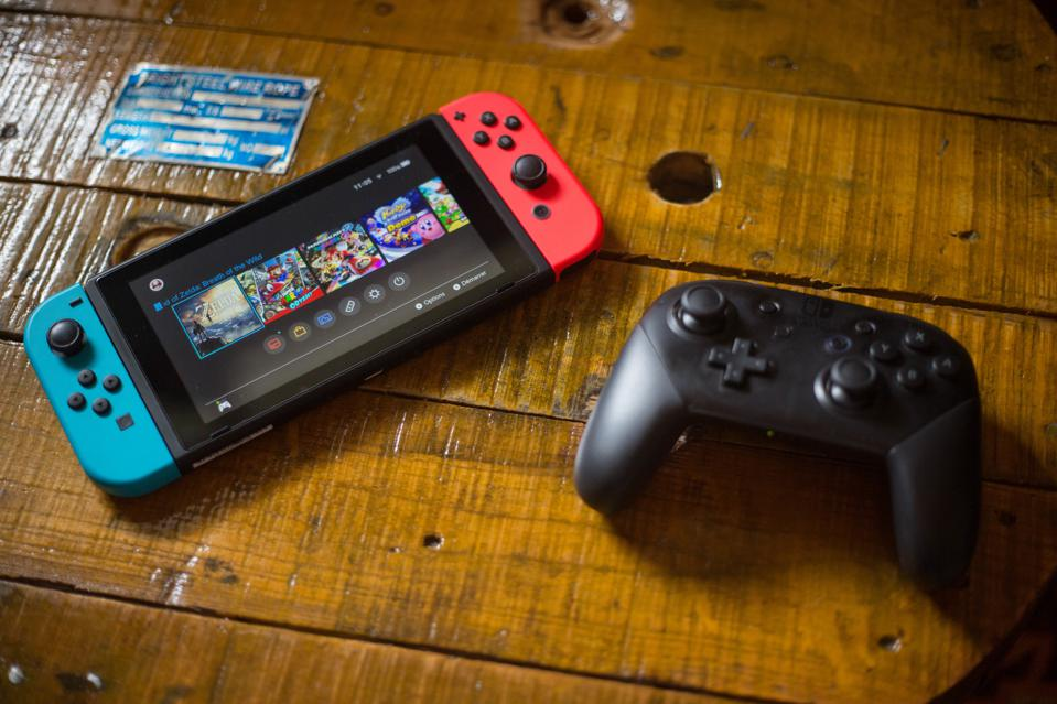 A turned on Nintendo Switch with 2 Joy-Con attached on it