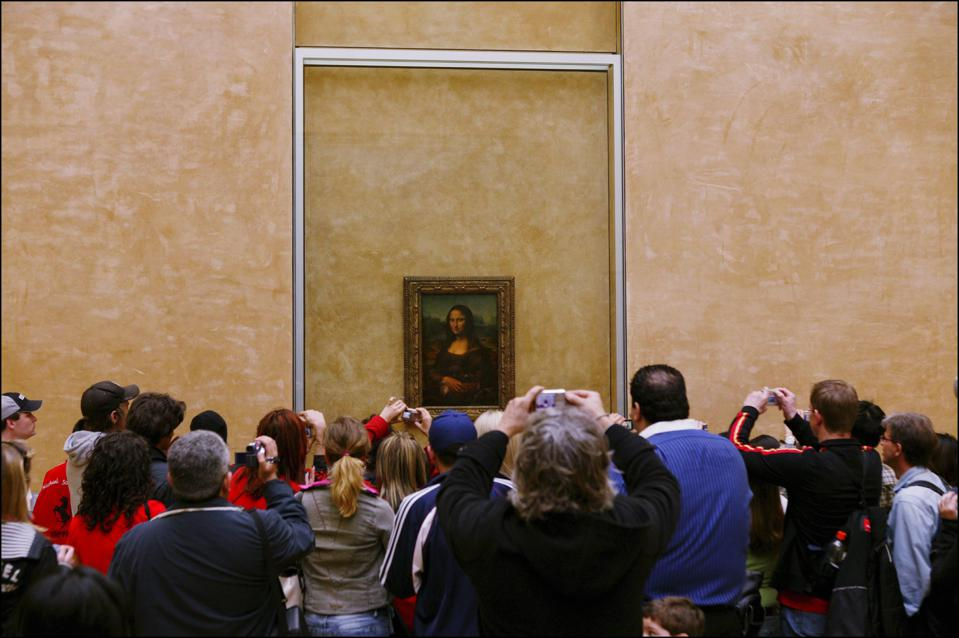 Mona Lisa relocated in the Louvre's Salle des Etats.