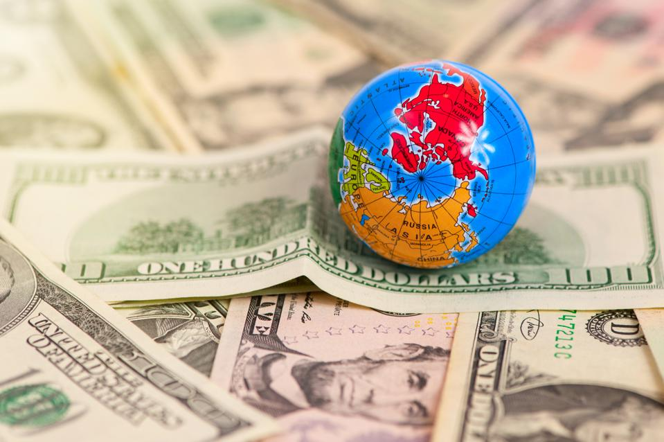 Globe map over many american dollar banknotes