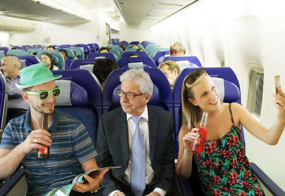 Travellers should expect passengers to be back in middle seats soon.