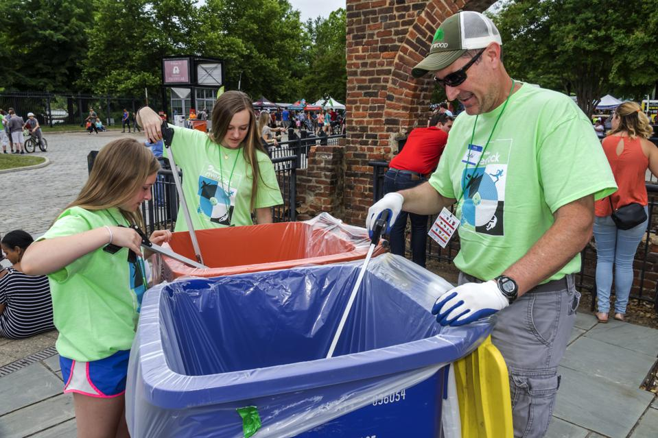 Virginia, Richmond, recycling event with family and daughters