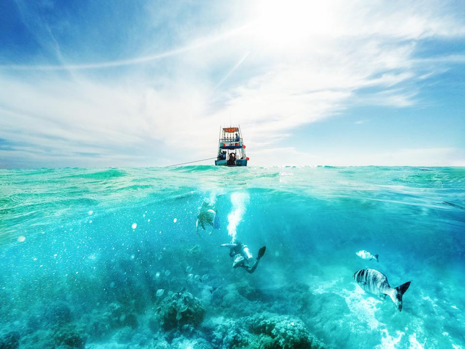 Divers and Boat in the Caribbean Sea