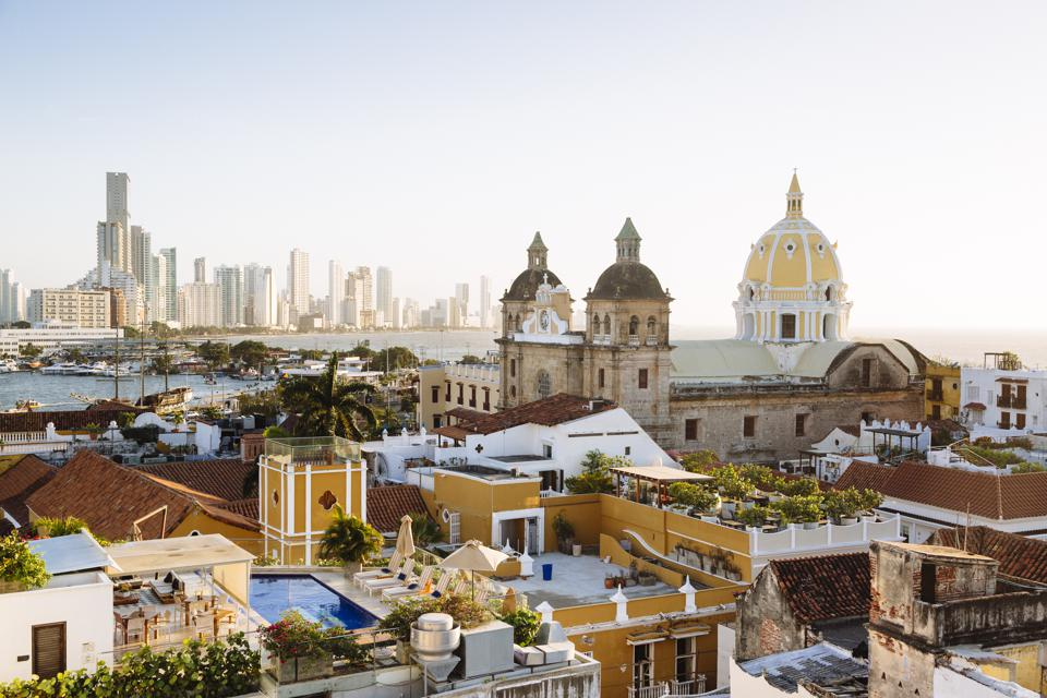 Skyline of Cartagena with the Church of San Pedro Claver and Monastery and the modern building of Bocagrande in the background. Cartagena de Indias, Colombia.