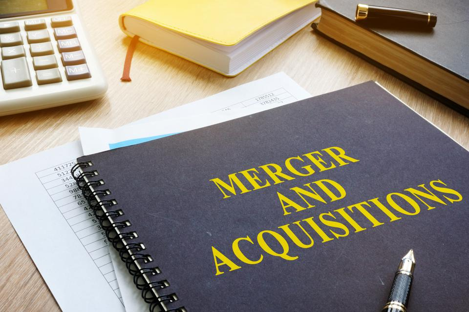 Book about Merger And Acquisitions M&A on a desk.