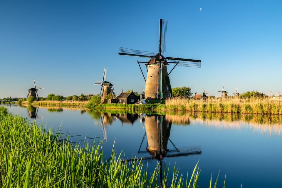 Windmills, Sunrise at Kinderdijk, Netherlands.