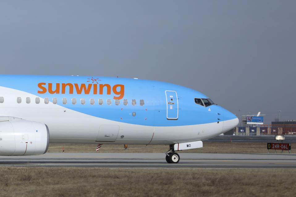 Sunwing Boeing 737-8K5... coronavirus travel COVID-19